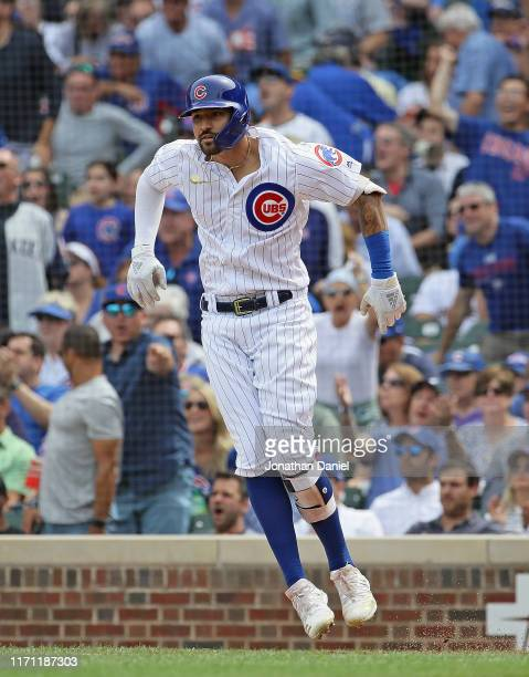 Nicholas Castellanos of the Chicago Cubs leaps in celebration after hitting his second two run home run in the 2nd inning against the Milwaukee...