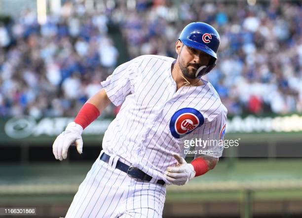 Nicholas Castellanos of the Chicago Cubs runs the bases after hitting a home run against the Oakland Athletics during the first inning at Wrigley...