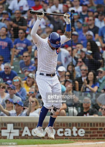 Nicholas Castellanos of the Chicago Cubs throws down his bat after hitting his second two run home run in the 2nd inning against the Milwaukee...