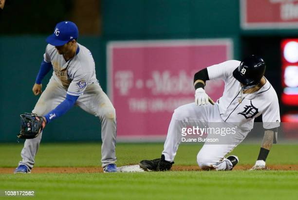 Nicholas Castellanos of the Detroit Tigers beats the throw to second baseman Whit Merrifield of the Kansas City Royals for a double during the...