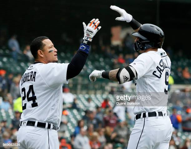 Nicholas Castellanos of the Detroit Tigers celebrates his tworun home run with teammate with Miguel Cabrera against the Kansas City Royals during the...