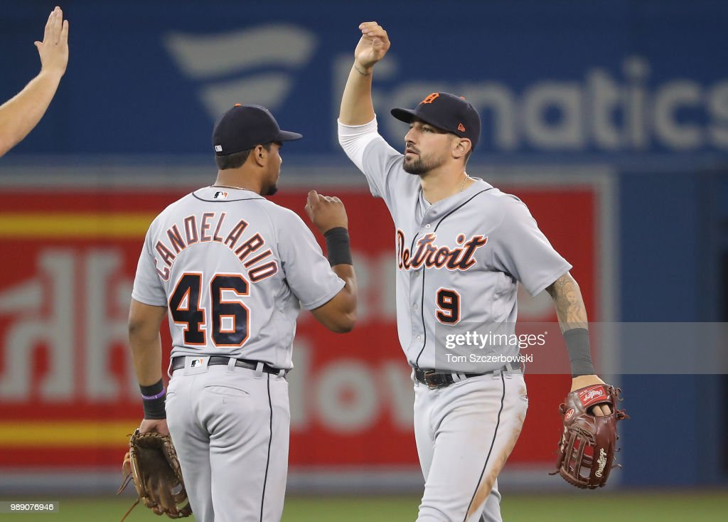Nicholas Castellanos #9 of the Detroit Tigers celebrates their victory with Jeimer Candelario #46 during MLB game action against the Toronto Blue Jays at Rogers Centre on July 1, 2018 in Toronto, Canada.