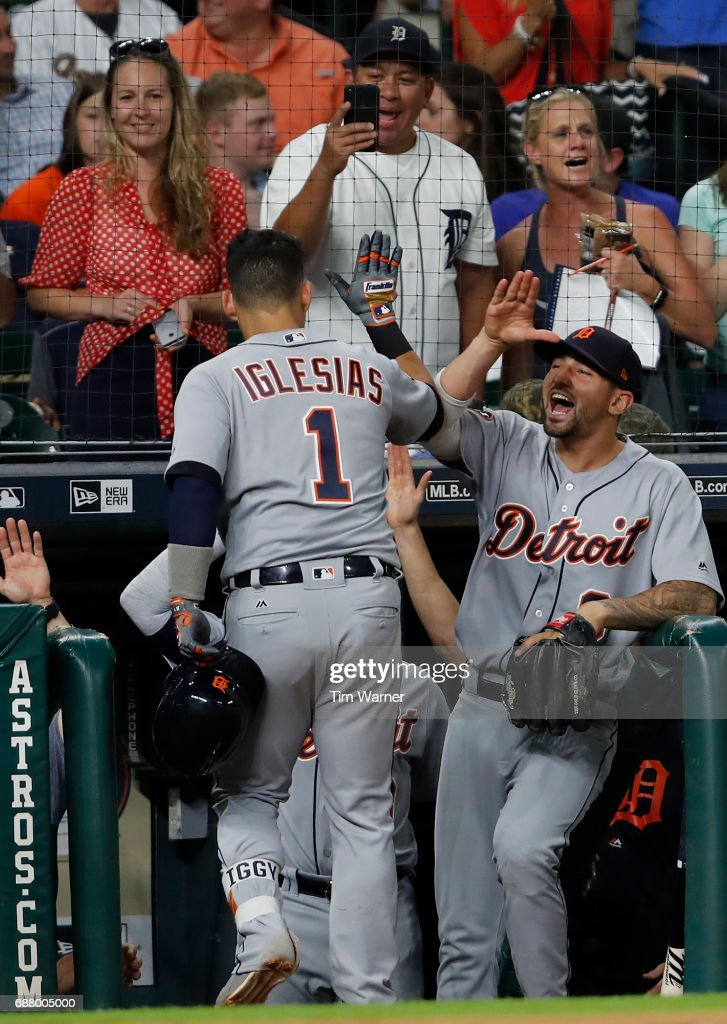 Nicholas Castellanos #9 of the Detroit Tigers celebrates with Jose Iglesias #1 after a ninth-inning home run against the Houston Astros at Minute Maid Park on May 24, 2017 in Houston, Texas.
