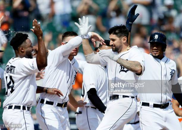 Nicholas Castellanos of the Detroit Tigers celebrates with teammates Christin Stewart JaCoby Jones and Jeimer Candelario right after hitting a walk...