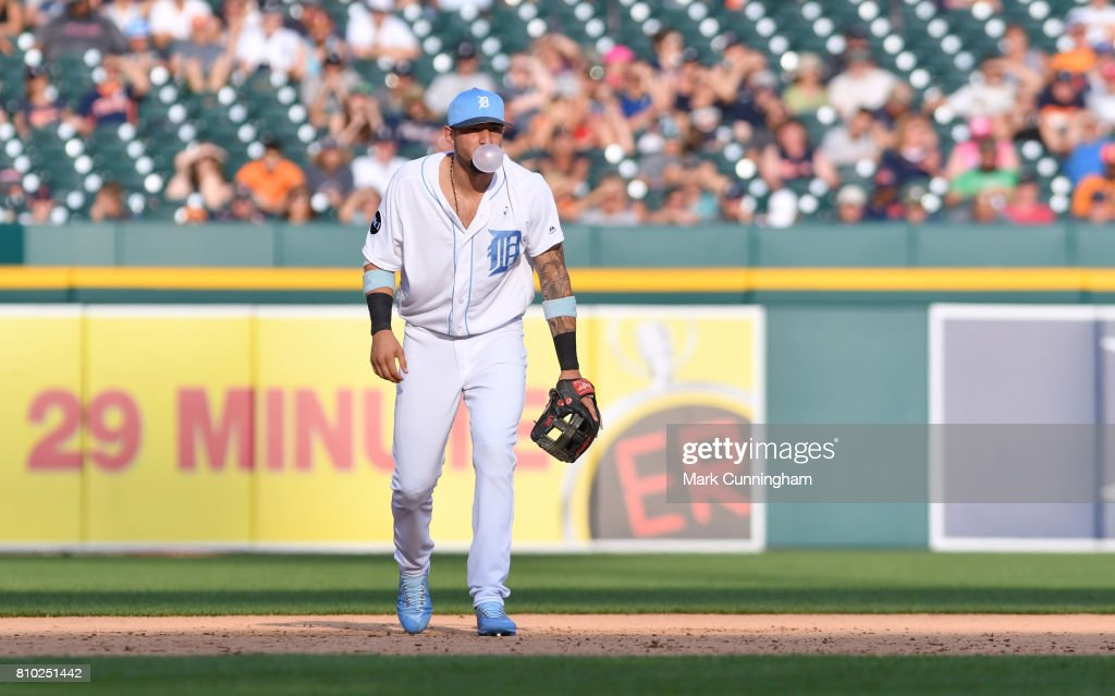 Nicholas Castellanos #9 of the Detroit Tigers fields while blowing a bubble during the game against the Tampa Bay Rays while wearing a special blue jersey, shoes and hat for prostate cancer awareness on Father's Day Weekend at Comerica Park on June 17, 2017 in Detroit, Michigan. The Rays defeated the Tigers 3-2.