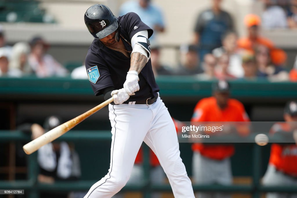 Nicholas Castellanos #9 of the Detroit Tigers hits a RBI single during the first inning of the Spring Training game against the Miami Marlins at Joker Marchant Stadium on March 02, 2018 in Lakeland, Florida.