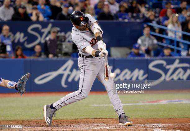 Nicholas Castellanos of the Detroit Tigers hits an RBI single in the eleventh inning during MLB game action against the Toronto Blue Jays at Rogers...
