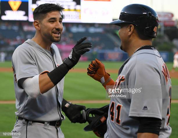 Nicholas Castellanos of the Detroit Tigers is congratulated on his first inning home run by Victor Martinez against the Los Angeles Angels of Anaheim...