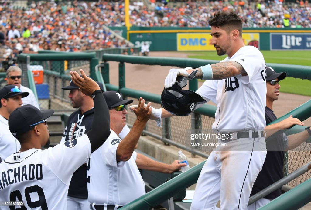 Nicholas Castellanos #9 of the Detroit Tigers is greeted by teammates in the dugout after scoring a run during the game against the Toronto Blue Jays at Comerica Park on July 16, 2017 in Detroit, Michigan. The Tigers defeated the Blue Jays 6-5.