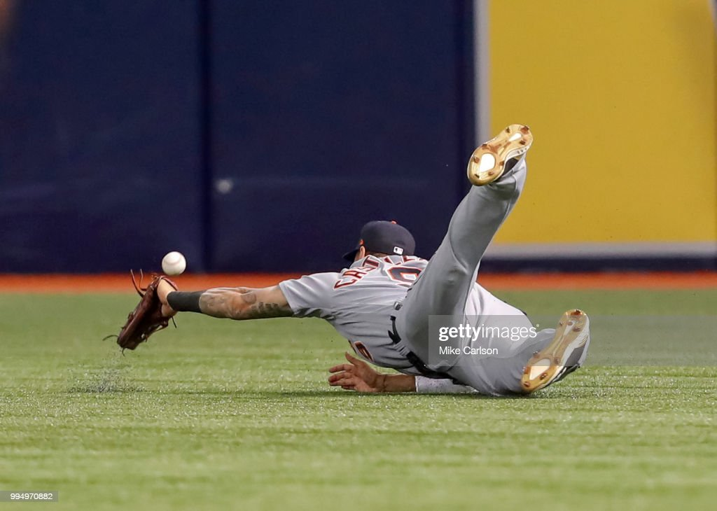 Nicholas Castellanos #9 of the Detroit Tigers misplays a fly ball from Adeiny Hechavarria #11 of the Tampa Bay Rays in the first inning of a baseball game at Tropicana Field on July 9, 2018 in St. Petersburg, Florida.