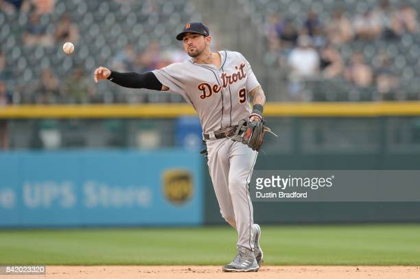 Nicholas Castellanos of the Detroit Tigers puts out a runner from a shifted defensive position in the seventh inning of a game at Coors Field on...