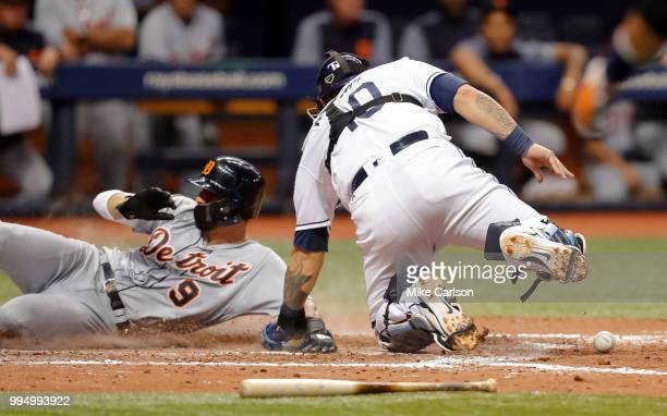Nicholas Castellanos of the Detroit Tigers scores after Wilson Ramos of the Tampa Bay Rays does not have the ball when applying the tag in the...