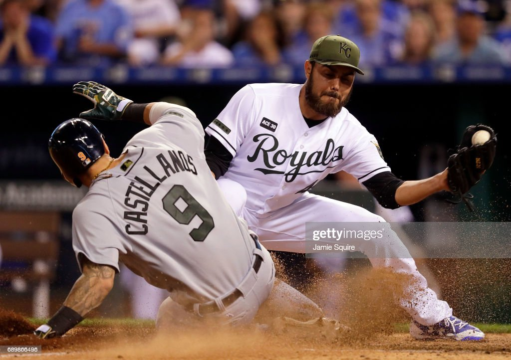 Nicholas Castellanos #9 of the Detroit Tigers slides safely into home to score on a wild pitch as pitcher Joakim Soria #48 of the Kansas City Royals covers the plate during the 8th inning of the game at Kauffman Stadium on May 29, 2017 in Kansas City, Missouri.