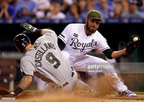 Nicholas Castellanos of the Detroit Tigers slides safely into home to score on a wild pitch as pitcher Joakim Soria of the Kansas City Royals covers...