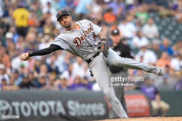 Nicholas Castellanos of the Detroit Tigers throws to first base for an out after fielding a soft ground ball in the sixth inning of a game at Coors...