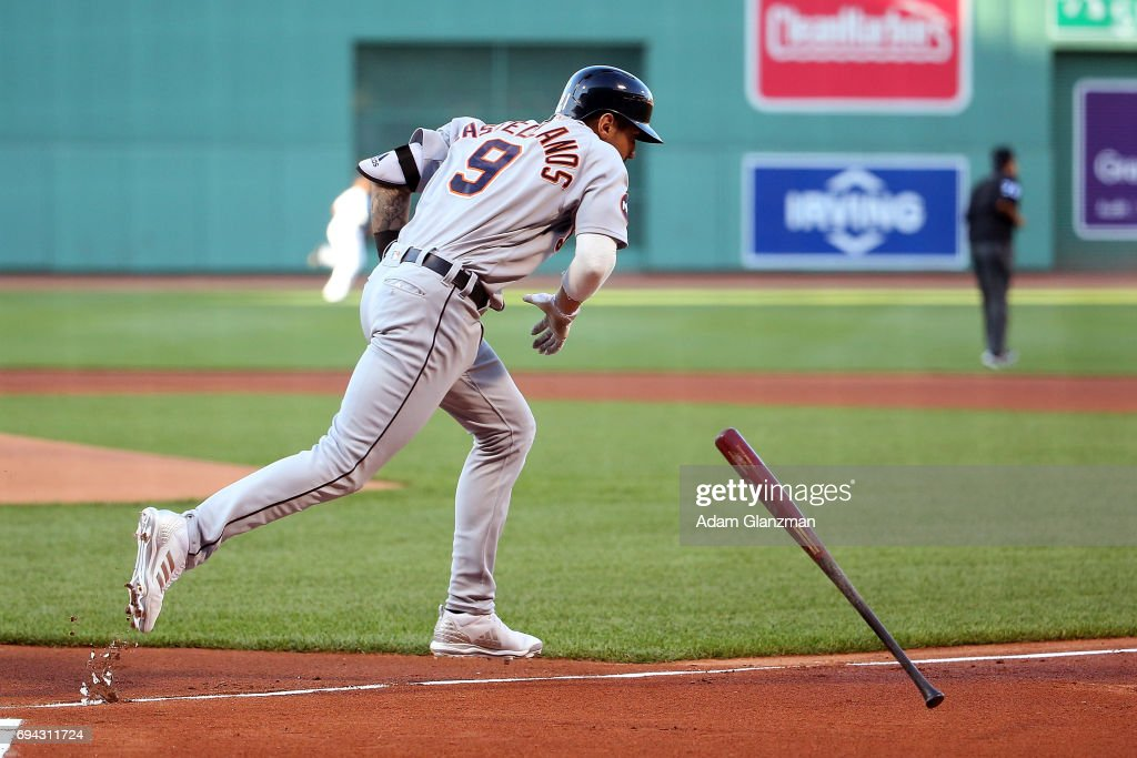 Nicholas Castellanos #9 of the Detroit Tigers tosses his bat after hitting a solo home run in the first inning of a game against the Boston Red Sox at Fenway Park on June 9, 2017 in Boston, Massachusetts.