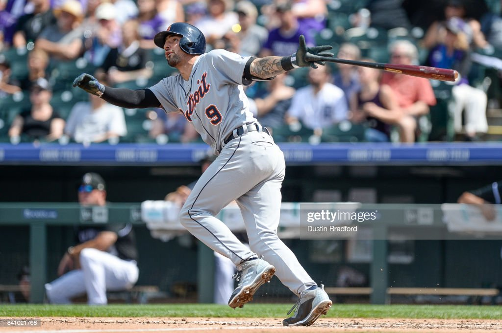 Nicholas Castellanos #9 of the Detroit Tigers watches the flight of a third inning solo homerun against the Colorado Rockies during a game at Coors Field on August 30, 2017 in Denver, Colorado.