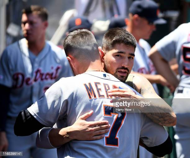 Nicholas Castellanos says goodbye to Jordy Mercer of the Detroit Tigers in the dugout after being traded to the Chicago Cubs during the first inning...