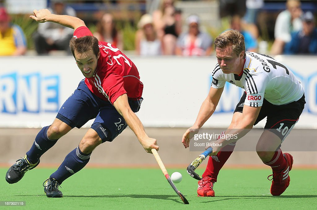 Nicholas Catlin of England and Mats Grambusch of Germany contest for the ball during the match between England and Germany during day two of the Champions Trophy on December 2, 2012 in Melbourne, Australia.