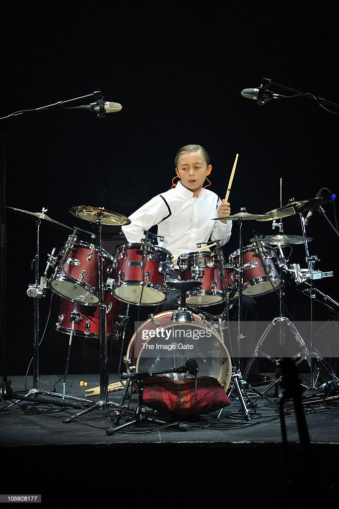 Nicholas Collins, plays drums as his father Phil Collins, was unable to perform due to his hand condition, during the Little Dreams Foundation 10th Anniversary Gala at Leman Theatre on October 21, 2010 in Geneva, Switzerland.