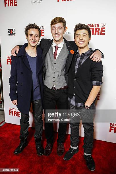 Nicholas Coombe Joshua Ballard and Bradley Steven Perry arrive to the Disney XD Pants On Fire premiere on November 4 2014 in Hollywood California