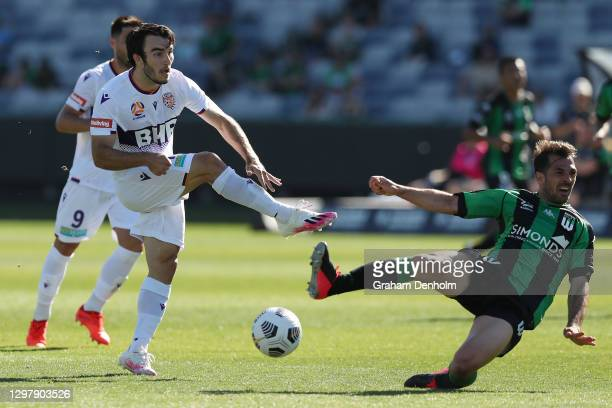 Nicholas D'Agostino of the Glory shoots as Victor Sanchez of Western United slides in to tackle during the A-League match between Western United and...