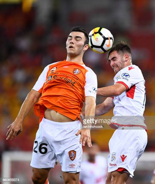 Nicholas D'Agostino of the Roar and Ben Garuccio of Adelaide United contest the ball during the round two ALeague match between the Brisbane Roar and...