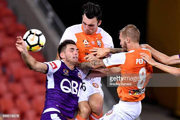 Nicholas D'Agostino of the Roar and Brandon Wilson of the Glory compete for the ball during the round 11 ALeague match between the Brisbane Roar and...
