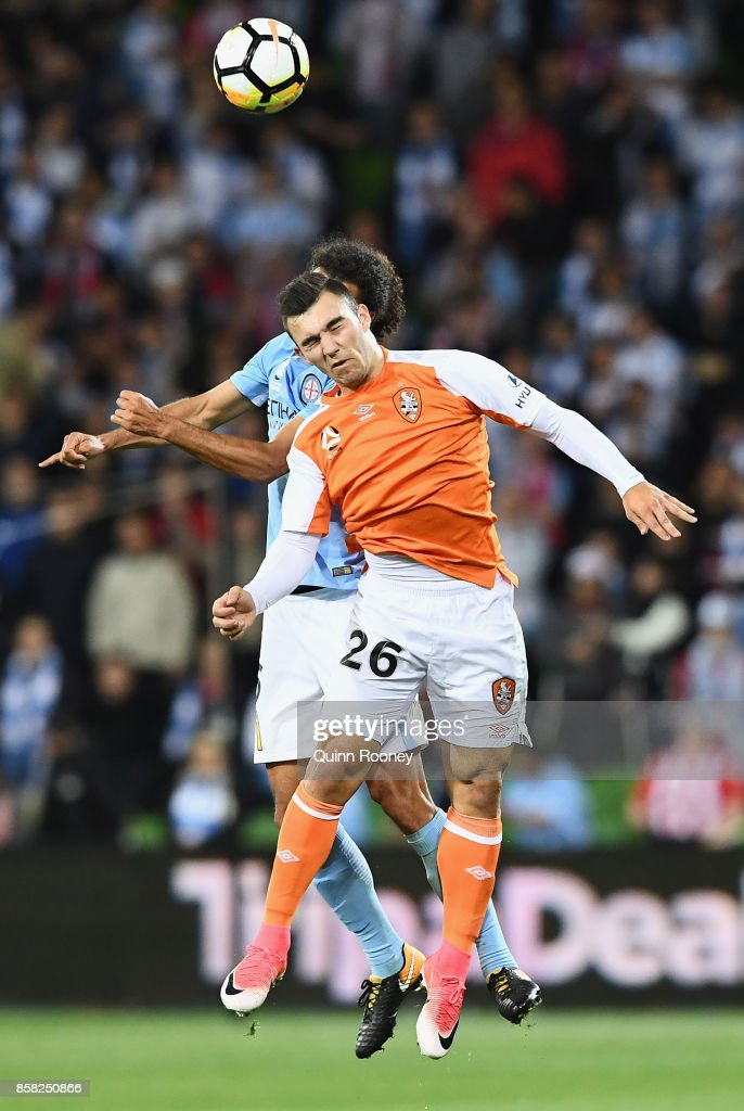 Nicholas D'Agostino of the Roar and Osama Malik of the City compete to head the ball during the round one A-League match between Melbourne City FC and the Brisbane Roar at AAMI Park on October 6, 2017 in Melbourne, Australia.