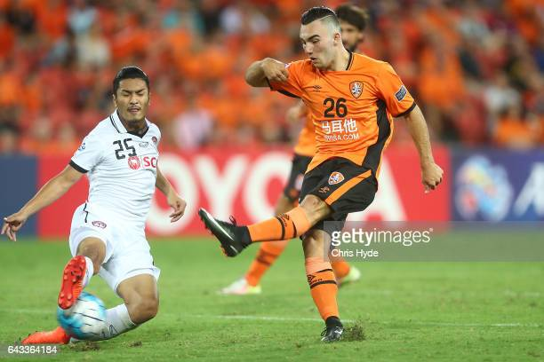 Nicholas D'Agostino of the Roar kicks past Adison Promrak of Muangthong United during the AFC Champions League match between the Brisbane Roar and...