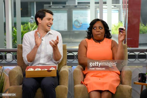 Nicholas D'Agosto and Sherri Shepherd eat cupcakes at Hollywood Today Live at W Hollywood on April 17 2017 in Hollywood California