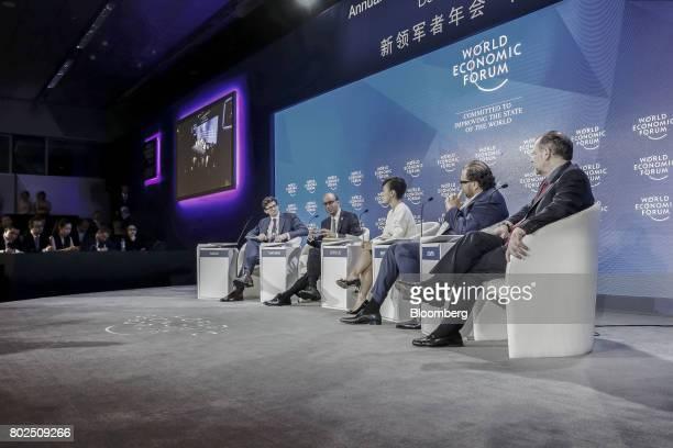 Nicholas Davis head of Society Innovation at the World Economic Forum from left Tharman Shanmugaratnam Singapore's deputy prime minister Jean Liu...