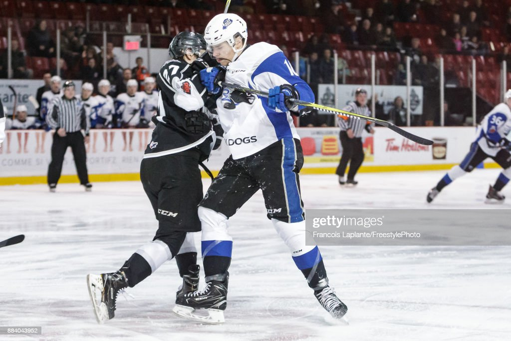 Nicholas Deakin-Poot #16 of the Saint John Sea Dogs checks Anthony Gagnon #27 of the Gatineau Olympiques on December 1, 2017 at Robert Guertin Arena in Gatineau, Quebec, Canada.