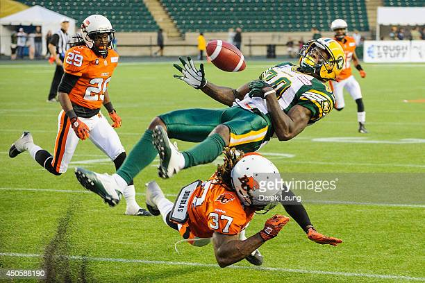 Nicholas Edwards of the Edmonton Eskimos misses his catch after being rushed by Ronnie Yell of the BC Lions during a CFL game at Commonwealth Stadium...