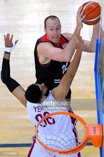 Nicholas Fazekas of Japan and Abdelrahman Yehia Abdelhaleem of Qatar compete for the ball during the FIBA World Cup Asian Qualifier 2nd Round Group F...