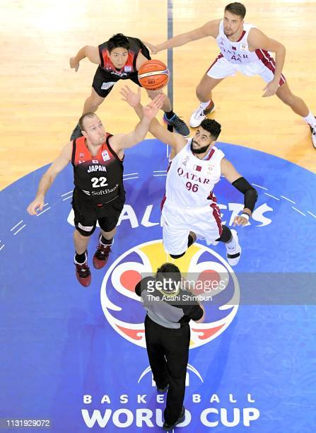 Nicholas Fazekas of Japan and Abdelrahman Yehia Abdelhaleem of Qatar compete at the tip off during the FIBA World Cup Asian Qualifier 2nd Round Group...