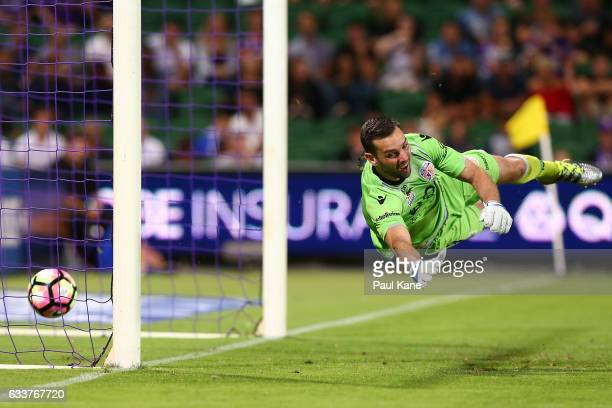 Nicholas Feely of the Glory misses a shot on goal by Andrew Hoole of the Jets during the round 18 ALeague match between the Perth Glory and the...