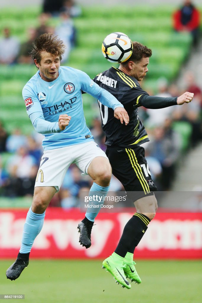 Nicholas Fitzgerald of the City (L) and Michael McGlinchey of Wellington Phoenix compete for the ball during the round three A-League match between Melbourne City and the Wellington Phoenix at AAMI Park on October 21, 2017 in Melbourne, Australia.