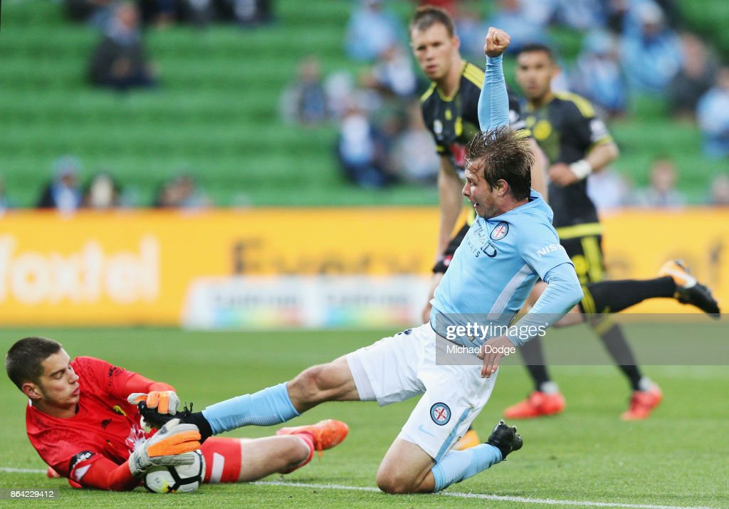 Nicholas Fitzgerald of the City has his goal attempt stopped by Goalkeeper Keegan Smith of Wellington Phoenix during the round three A-League match between Melbourne City and the Wellington Phoenix at AAMI Park on October 21, 2017 in Melbourne, Australia.