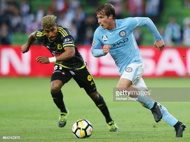 Nicholas Fitzgerald of the City runs with the ball from Roy Krishna of Wellington Phoenix during the round three ALeague match between Melbourne City...