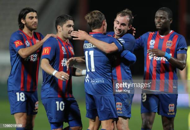 Nicholas Fitzgerald of the Jets celebrates with Angus Thurgate after scoring a goal during the round 24 A-League match between the Newcastle Jets and...