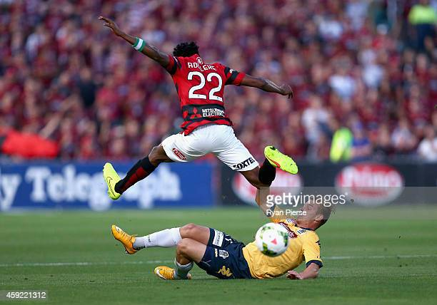 Nicholas Fitzgerald of the Mariners tackles Seyi Adeleke of the Wanderers during the round three ALeague match between the Western Sydney Wanderers...