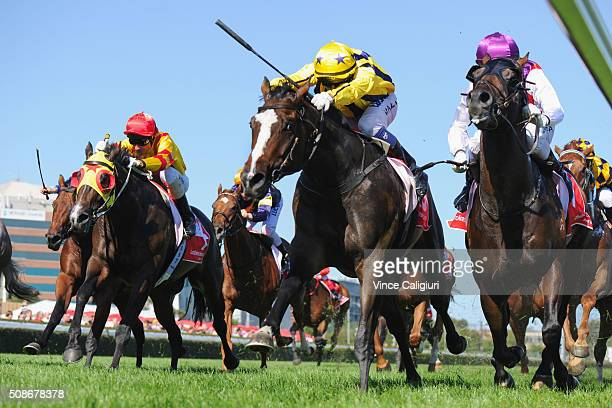 Nicholas Hall riding Puritan defeats Mark Zahra riding Golden Spin and Glenn Boss riding Ready for Victory in Race 8 the Manfred Stakes during...