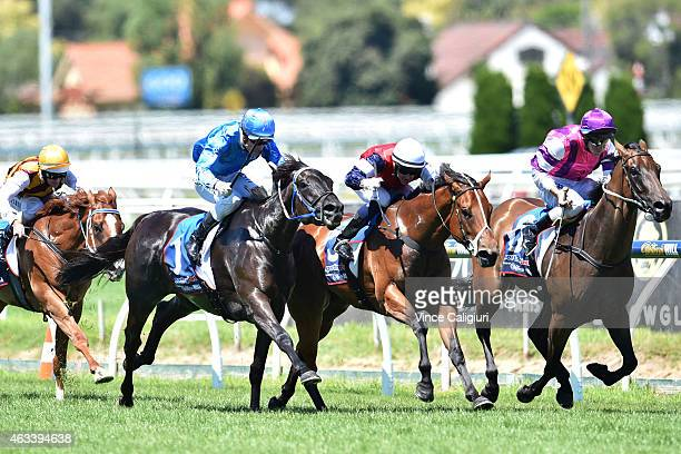 Nicholas Hall riding Sabatini defeats Dale Smith riding Royal Snitzel and Mark Zahra riding Fontein Ruby in Race 2 the Kevin Hayes Stakes during...