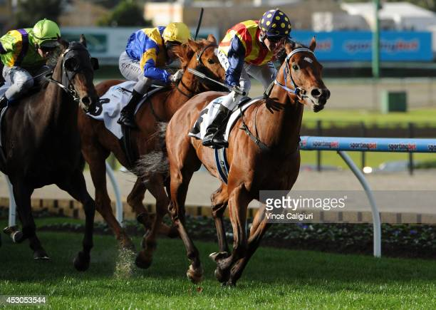 Nicholas Hall riding Under the Louvre wins Race 7 the 1Print Handicap during Melbourne racing at Moonee Valley Racecourse on August 2 2014 in...