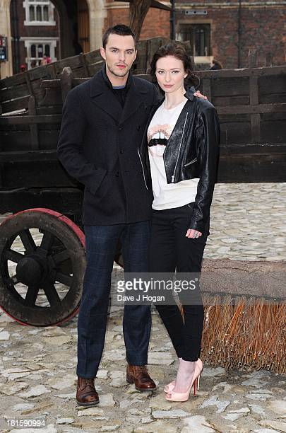 Nicholas Hoult and Eleanor Tomlinson attend a photocall for 'Jack The Giant Slayer' at Hampton Court Palace on February 12 2013 in London England