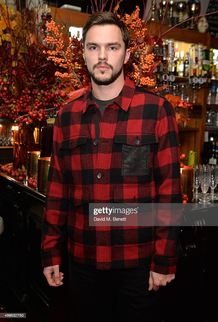 Nicholas Hoult attends the Thanksgiving dinner with Coach hosted by Zoe Kravitz and Mary Charteris on November 24, 2014 in London, England.
