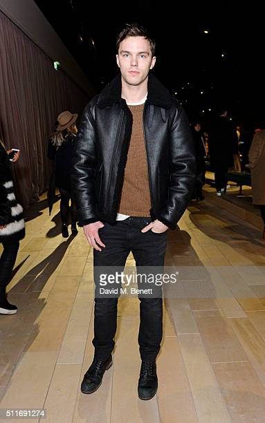 Nicholas Hoult wearing Burberry at the Burberry Womenswear February 2016 Show at Kensington Gardens on February 22 2016 in London England