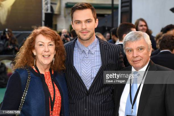 Nicholas Hoult with parents Glenis Brown and Roger Hoult attend the Tolkien UK premiere at The Curzon Mayfair on April 29 2019 in London England