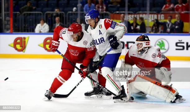 Nicholas Jensen of Denmark challenges Diego Kostner of Italy for the puck during the 2017 IIHF Ice Hockey World Championship game between Denmark and...